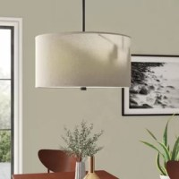 This four-light indoor modern chandelier offered in a burnt sienna or brushed nickel finish conveys a tailored look while creating both ambient and task lighting. The sleek, fabric shades and smooth acrylic diffusers create a warm glow for any focal point in your space.