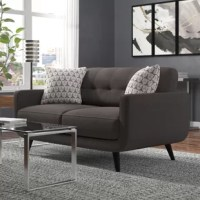 Express yourself and improve your decor with this mid-century inspired loveseat. Skillfully crafted with clean lines, beautiful curves, comfortable plush seat cushions and carefully tufted back cushion; this set is a fusion of modern and classic style. Outfitted with solid espresso legs and soft upholstered fabric, this Collection will be the perfect design piece for your media room, living room, loft, lounge office and orthink tanks.