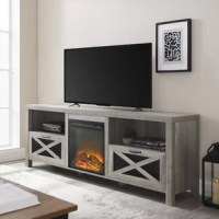 """Buckle down on farmhouse charm without having to wander out to an actual barn to gather firewood thanks to the electric fireplace TV stand. The heater comes with a faux wood hearth and the ability to control the light and heat options separately on the unit so you can achieve a variety of ambiances at the flip of a switch. This rustic console with mesh metal drop door cabinets includes cord management, open and closed storage, and can accommodate up to a 78"""" TV."""