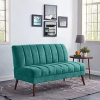 Round out your living room layout with this streamlined loveseat. Taking cues from mid-century modern designs, this piece is founded atop four splayed legs that can support up to 600 lbs. A foam fill and synthetic fiber cushion the pine and plywood frame, while polyester upholstery in a solid hue envelops the design for an approachable look. Channel-stitching details dot the back and seat for a touch of texture. Assembly is required.