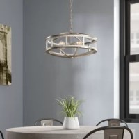 The chandelier features an open frame with an acacia wood color finish, paired with brushed nickel hardware. Drawing inspiration from farmhouse collections, boasting vintage bulbs, this piece is guaranteed to make a statement without overpowering your existing decor. Emitting a gentle, warm glow, this chandelier creates a cozy atmosphere in any kitchen space.