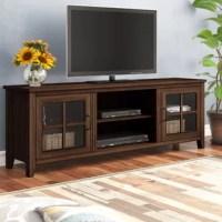 Showcasing windowpane cabinet doors, this Dake TV Stand for TVs up to 78