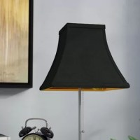 As we all know, shopping for fixtures can cost an arm and a leg. To save money, and appendages, reach for a replacement shade. They offer a fun, budget-friendly way to make old lamps look new again. This 8'' bell-shaped silk shantung shade showcases a neutral look perfect for a variety of aesthetics. Its unobtrusive black hue blends in with neutral color palettes, while a clip-on attachment makes it easy to add to a base of your choice.