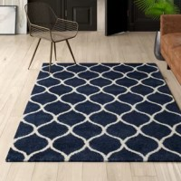 Red carpets aren't the only way to add glamorous and chic style to your floors. Add this elegant rug to any space in your home to effortlessly elevate your aesthetic and craft a look that is sure to grab glances. Showcasing a classic trellis pattern, a bold blue, and ivory color palette, and a shag design, this design is a must-have for your home. It was power-loomed of easy-care polypropylene yarn, so it is stain- and fade-resistant, and an ideal choice for spill-prone spaces and...