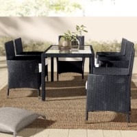 Enjoy al fresco dining in a clean, contemporary style with this seven-piece dining set! Founded on a steel frame, the table strikes a clean-lined rectangular silhouette with four straight square legs wrapped in tightly-woven resin wicker. Rounding out the design, a tinted tempered glass tabletop provides a stylish, easy-to-clean surface for drinks to dinners. Six matching wicker chairs each feature full backs and gently-flared arms, while a detachable foam-filled cotton cushion lines each seat...