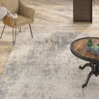 At home in a country cabin or urban loft, this Textures Abstract Ivory/Silver Gray Area Rug collection blends earthen tones and contemporary abstracts together in beautifully textured modern rugs that are sure to bring a rustic sensibility to any decor.