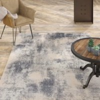 At home in a country cabin or urban loft, this Textures Abstract Ivory/Gray Area Rug collection blends earthen tones and contemporary abstracts together in beautifully textured modern rugs that are sure to bring a rustic sensibility to any decor.
