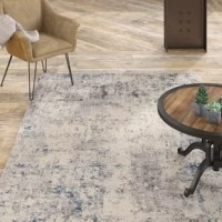 At home in a country cabin or urban loft, this Textures Abstract Ivory/Blue Area Rug collection blends earthen tones and contemporary abstracts together in beautifully textured modern rugs that are sure to bring a rustic sensibility to any decor.