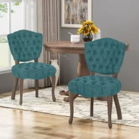 This dining chair combines classic elements for a gorgeous design with a stunning mix of button tufting and scrolled legs. From exquisite diamond stitching to its weathered finish, it will instantly uplift the ambiance of your kitchen or dining room.