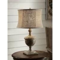 The Laoise 29.5'' Table Lamp comes in an antique wood finish with an oatmeal linen shade.