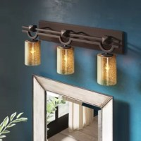 This Salinas 3-Light Vanity Light offers a wide selection of handcrafted artisan glass shades. This beautiful artisan glass finishes complement the clean designs of this fixtures.