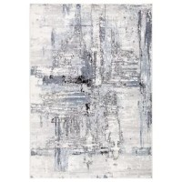 A modernist's dream, this icy-toned area rug showcases a distinctive abstract pattern. The durable polyester and polypropylene pile features carved-like details for added texture and dimension.