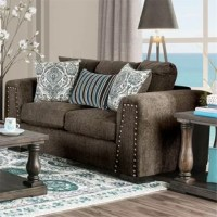 Well-made, solid, substantial, are just a few words to describe this loveseat. It features strong blocky shapes, highlighted by the nailhead detailing on the large track arms. The added throw pillows bring playful patterns and colors while giving this set a touch of modernity.