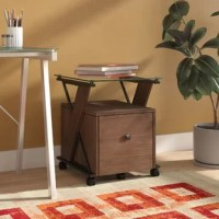 Manage your important documents with this 1 Drawer Mobile Vertical Filing Cabinet. Contrasting black nickel plated metal, roasted caramel wood veneers, and a tempered glass top exudes urban cool for the modern home office. An easy glide, caster base allows for free movement, or keep it in place with the front locking casters.