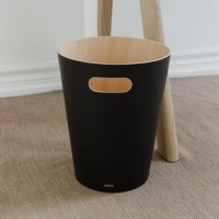 Add modern, contemporary style to a basic household essential. Introducing WOODROW Waste Can by Umbra. Made of natural treated wood curved into a can shape, WOODROW warms and grounds a room, even though its core function is being a garbage can. Use WOODROW to add a modern, subtle decorative touch to your powder room, bathroom, office, study or wherever you choose to put it. This two-tone waste can fill any room with modern contemporary aesthetic and makes a great home office wastebasket or...