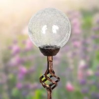Exquisite illuminating solar crackle glass ball stake adds a decorative touch to your garden day and night. As the sun sets and dusk settles in, your beautiful glass stake glows from within. The spiraling metal finial adds and an extra touch of elegance. It makes a thoughtful gift and a wonderful addition to any landscape.