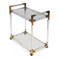 They present a tea cart with inspired details. Each corner connection has stainless steel connections that have a gold-tone finish. Both glass shelves are tempered glass.