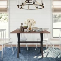 This foldable dining table is a perfect centerpiece for your breakfast nook, dinette, or small dining room. It features drop-leaf sides that expand the table surface as desired.  This multipurpose furniture is also useful as a desk, makeup console, or crafts table.