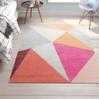 Providing a modern twist with its geometric gray and pink design, this area rug is sure to stand out in your teen's living space. Made in India, it is woven from nylon and features a low 0.33'' pile height for a design that's ideal for placement in high-traffic areas. As a bonus, it's easy to clean and non-shedding. We recommend adding a non-slip rug pad for optimum performance on hardwood floors.