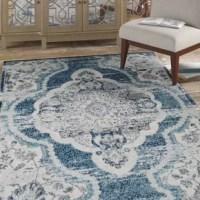 Make a sophisticated statement with this Whitford Entourage Distressed Vintage Floral Persian Medallion Gray/Blue Area Rug. Patterned with an elegant design, this is a soft and durable machine-woven polypropylene rug that offers wide-ranging support. Complete with a gripping rubber bottom, this enhances traditional and contemporary modern decors while outlasting everyday use. The area rug is a perfect addition to the living room, bedroom, entryway, kitchen, dining room or family room. This is a...
