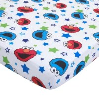 This bedding set includes a bright blue comforter featuring Elmo and Cookie popping from a pattern of blue, green, and white stars. Matching fitted and flat sheets come in a crisp white with a fun, coordinating pattern of Elmo, Cookie, and stars in shades of red, blue, and green. Elmo bursts from the front of the blue, star-patterned pillow case, while Cookie peeks from the green backside. All pieces made of 100% polyester. Surprise your sweetie with this adorable set today!