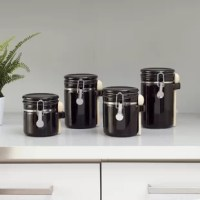 Organize the pantry or add a touch of charm to the kitchen counter with this ceramic kitchen canister set, complete with four petite pieces that are perfect for stashing spices, tea leaves, coffee beans, and small quantities of baking supplies. Made from glossy ceramic, they feature lift-top lids with airtight seals for freshness. Though each design differs in size (ranging from 5