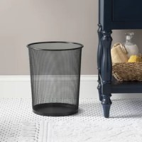 Keep your bedroom or bathroom clear of clutter with this handy waste basket. Crafted from metal, it features a solid color hue that works well in modern spaces, and a mesh design for a sleek look. Its 13.75'' H x 12'' W measurement fits in the corner of any room you need it, and its round shape is capable of holding up to four gallons. Available in a variety of colors, you can choose the perfect piece for your contemporary decor.