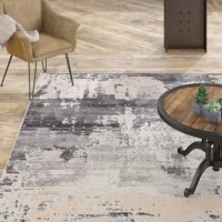 Modern and statement-making, this striking area rug features a painterly-inspired design. This rug's soft and ridged, low pile combine with the durability of polyester and polypropylene for the perfect anchor in any sleek space.