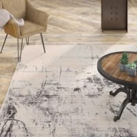 Modern and statement-making, this striking area rug features an abstract painterly-inspired design. This rug's soft and ridged, low pile combine with the durability of polyester and polypropylene for the perfect anchor in any sleek space.