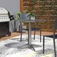 Enhance the modern decor of your commercial or residential property with this Bistro Dining Table. This lovely dining table comes fitted with a high-quality stainless steel round top that is extremely long lasting. This top is embellished with striking geometric pattern that instantly grabs attention.The wrap around edges of the top smoothens out the alloy's sharp edges, making it easy to transport the table from one location to another. The edges also enhance the look of the table...