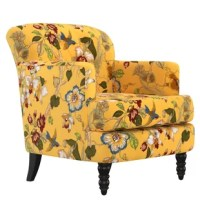 Green-thumbed at heart? There's no need to keep the garden outside in the yard—with this eye-catching armchair, you can introduce a bit of blooming brilliance into any seating group. Featuring upholstery with a floral motif awash in creamy ivory, blue, red and yellow tones, this armchair is sure to bring a touch of timeless charm to your aesthetic, while its turned feet lend a touch of understated style and classic appeal to the look. Set it next to a dark espresso-finished wood end table to...