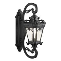 The Tournai™outdoor wall light features an ornate look with clear seeded glass that works in a traditional environment.
