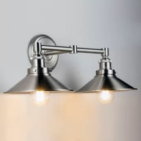 The industrial factory style Vanity Light is perfect for bathrooms, corridors, living areas and a variety of other spaces. The epitome of modern vintage, this light calls to mind industrial lighting from the 1900s and features easily adjustable positioning with a simple thumbscrew operation.