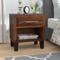 This Acacia Wood Night Stand is the perfect accent piece for any room in your home. Made from Acacia wood with an iron frame, this stand can double as both a storage and design element. With neutral colors and industrial touch, this nightstand will complement any bedroom decor it is placed next to.
