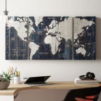 Frame your sofa or master bed in an artful style with this 3-piece wrapped canvas graphic art print. A great way to add a splash of color to white walls, this piece comes printed on gallery-grade canvas and wrapped around a wooden frame that works well in contemporary spaces. It showcases a map motif awash in hues of blue and white, making it the perfect pick for geography buffs and aspiring travelers. Made in the USA, this print adds color and texture to your bedroom or living room.