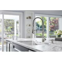 Distinguished by an elegant silhouette, this single handle kitchen faucet brings professional-level style and performance into home kitchens. The high-arch spout with an industrial-inspired spring coil design swivels 360 degrees for a complete field of reach.