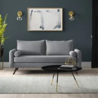 An ideal combination of traditional design with a mid-century vibe, this sofa makes the perfect anchor for your living room. Elegantly styled with a sleek contemporary feel, it showcases a tuxedo-style rectangular frame, boasting two back cushions and a bench-style seat cushion with a layer of foam for added comfort. Two bolster cushions sit next to its track arms, adding an extra element of style. Founded atop a manufactured wood frame, it showcases splayed legs to finish off the look.
