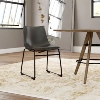 Bring the sophisticated look of leather seating to your kitchen, dining room, or entertainment area. These Upholstered Dining Chairs are the perfect addition and great for everyday use. The synthetic leather is soft to the touch while its curved seating provides comfort.