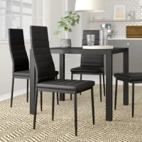 Bring your dining room ensemble into the 21st century or refresh the breakfast nook with this stylish side chair. Understated in its silhouette, its frame is crafted from black-finished metal and measures 37.8'' H x 20.5'' W x 16.5'' D. The tapered-back and seat are padded with synthetic fiber, then wrapped in unfussy polyester blend upholstery in black to tie it all together. This design arrives in a set of four, so you can create a cohesive entertainment space.