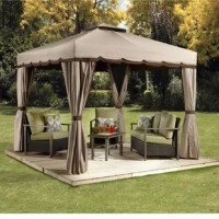 Give your outdoor space a makeover with this gazebo. Perfect for creating a shady space to lounge or settle in for a meal, this gazebo is crafted with an aluminum and steel frame, and features a polyester roof with a scalloped edge to help keep the sun and rain off your outdoor arrangement. Included mesh screens and side panels help add a little privacy and keep bugs and other pests out of your space while you relax. This piece must be installed to a patio, deck, or foundation in order to be...