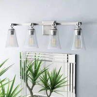 This four-light wall sconce in the chrome finish brings a mid-century, retro style to the traditional silhouette. A beautiful tapered clear seeded glass shade and exquisite details, including a cast backplate, cast ring, and hook hardware that elegantly support the shades. This light fixture will make a bold statement to any space, blending well with all design and color palettes.