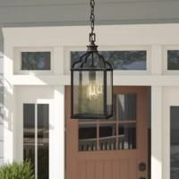 Illuminate your porch in tasteful, transitional style with this one-light outdoor pendant holder. Crafted of metal in an oil-rubbed bronze finish, this fixture features a streamlined cylindrical pendant holder complete with curvy ogee arms. Set within a clean-lined rectangular frame, panes of clear rain glass ensconce one 60 W incandescent A19 medium base bulb (not included) to diffuse bright light as it's dispersed throughout your space. Rounding out the design, an adjustable length of the...