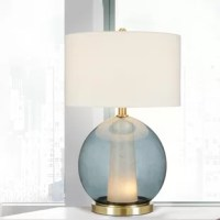 Illuminate your home in more ways than one with this table lamp. The sphere-shaped inner ambles tapered marbled glass houses the nightlight. This piece not only provides ambient uplight, but it also creates another layer of sophistication cast by the glow of the nightlight. Crafted with high-quality materials with brass metal accents and a 4-way rotary switch allowing you to choose the level of ambient light. This table lamp makes for the perfect statement piece on its own or for a 'wow' factor...