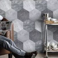 This concrete look hexagon tile is made to change the perception of peel and stick floor and wall tile. Its realistic, organic concrete look brings high-end modern value to your residential and commercial space. Installation is made easy with the self-adhesive feature. Despite the light, thin material, the tile is very durable and will stand tough under both water and fire.