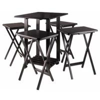 This table tray set is the perfect companion piece when you're entertaining or simply sharing a casual meal in front of the TV or on the patio. Four folding snack tables store neatly away underneath a double-drop leaf table that rolls easily on professional grade casters. Keep glasses, ice, hors d'oeuvres, and serving dishes on the expanding table top while using the individual folding snack trays for dining. All the tables have smooth, rounded edges and are made of solid wood to last over time...