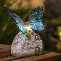 Add delicate touches of illuminated beauty with this butterfly solar garden stone.