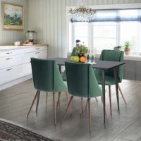 This eye-catching 5-piece dining set brings a bit of trendy appeal to your dining room or eat-in kitchen. The rectangular table features a solid wood top, straight edges and tapered legs for a mid-century-inspired silhouette. Set on tapered and splayed metal legs, the four dining chairs display a modern take on the classic wingback design. The seats are upholstered in velvet and filled with foam for some extra padding as you enjoy dinner with family or friends. Flange seams complete the chair's...