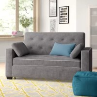 Doubling as a stylish seat and a spot to snooze, this versatile sleeper sofa converts into a queen-sized bed, so you can make the most of your square footage and host guests at a moment's notice. This item's wood frame is cushioned with foam to offer a medium-soft feel. Polyester microfiber upholstery in a neutral hue envelops the design for understated appeal, while button-tufted details and contrasting piped accenting completes the look with a dash of distinction.