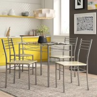 Whether hosting a dinner party with close friends or enjoying an everyday meal with the family, this five-piece dining set is a must-have for your home. Brimming with contemporary style, the included table strikes a rectangular silhouette, and is crafted from a sleek metal frame with a clear glass tabletop. Rounding out the look, the four matching chairs each feature an open, ladder style back for a breezy and modern feel.