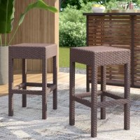 Contemporary style meets understated design with this breezy woven bar stool. Crafted of woven wicker in a deep brown finish, each stool features a clean-lined square seat with a thick edge. Rounding out the design, the four-legged base includes a built-in footrest for added comfort, while structural stretchers lend stability and support. Measuring 27.5